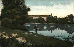 Man Fishing at Millpond