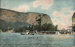 Chas. Nelson Making Canoe Mile Record Postcard