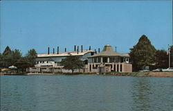 View from Lake of Visitors Center With Factory Bulding in Rear
