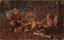 Man and Woman Around Campfire