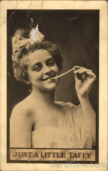 A Women Eating a Piece of Taffy