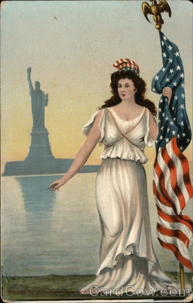 Women in White Dress Holding American Flag in fromt of the Statue of Liberty
