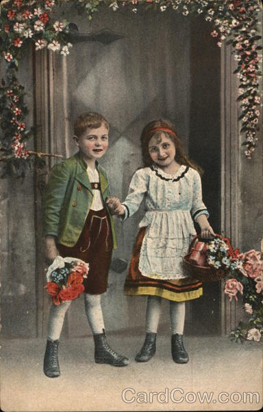 A By and Girl Holding Flowers Children