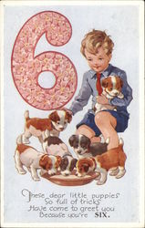 Little Boy with Six Puppies