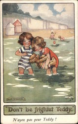 Two Kids Playing in the Water with a Teddy Bear