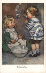 """Seifenblasen"" - Boy and Girl Blowing Soapbubbles"
