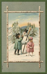 Two Young Girls Building a Snowman