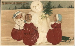 """A Happy Christmas To You"" - Three Children Building Snowman"