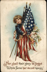 A Young Boy Holding American Flags