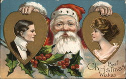 """Best Christmas Wishes"" Santa Holding Pictures of Man and Woman"