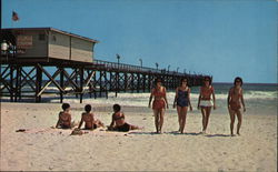 Sunbathers and View of Pier Postcard