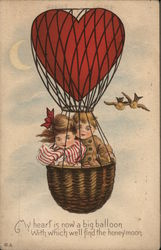 Boy and Girl in Heart-Shaped Balloon Basket