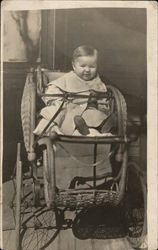 Child In Baby Carriage