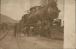 "Railroad Workers and ""104"" Locomotive"