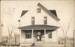Photo of House with Girl on Porch