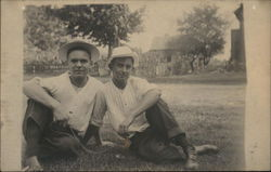 Snapshot of Two Men on Grass