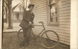 Man Leaning On Old Bicycle