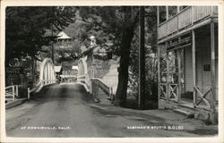 Road Showing Bridge, Riverside Motel and The Mountain Messenger Office