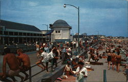 Bathers Along the Boardwalk and Beach