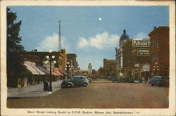 Main Street Looking South to CPR Station Postcard