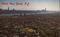 Aerial View of Town and Manhattan Skyline