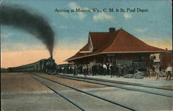 Arriving at C. M. & St. paul Depot Postcard