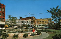 Street Scene and Fountain Downtown Postcard