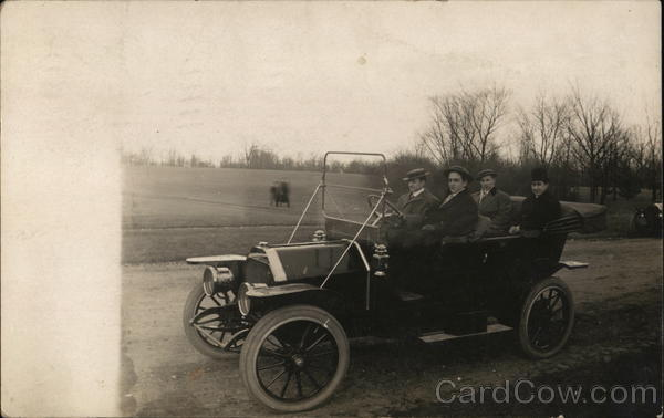 Four Men in Automobile Cars