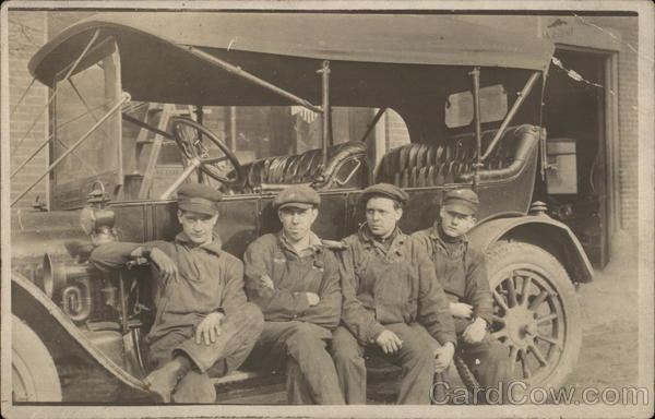 Snapshot of 4 Workers on Car Cars