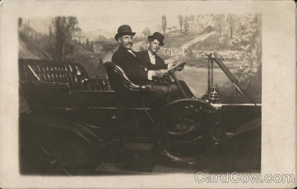 Two Men in Automobile Cars