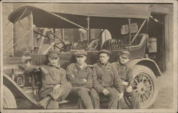 Snapshot of 4 Workers on Car