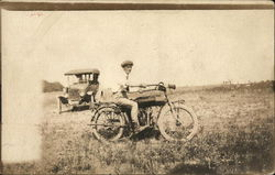 Man on Motorcycle in Field