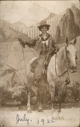 Cowgirl on Horse With Lassoo