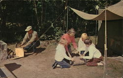 Family Setting Up Camp