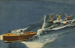 Three People Enjoy Water Skiing