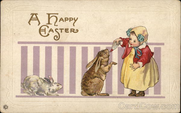A Happy Easter - Child Feeding Bottle to Bunny With Bunnies