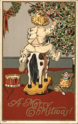Child On Toy Horse Near Christmas Tree