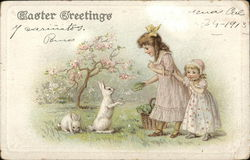 Easter Greeting: Two Girls Feed Lettuce to Rabbits