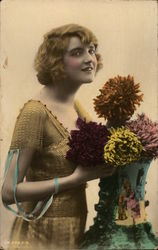 Woman Posing With Vase of Crysenthemums