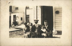 Snapshot of Family on Porch Postcard