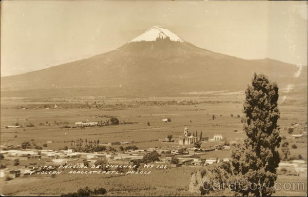 Partial view of Cholula and Popcatepetl Volcano Puebla Mexico