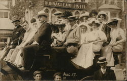 People seated in an early vehicle in front of Runnacleave Hotel, Aug. 17
