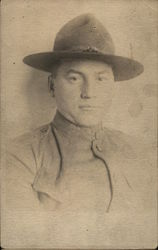 A man wearing a hat, possibly a soldier
