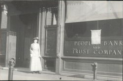Woman In Front of Peoples Bank and Trust Company Postcard