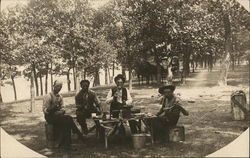 Men Eating in Park