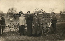 Three women and Man with Wagon