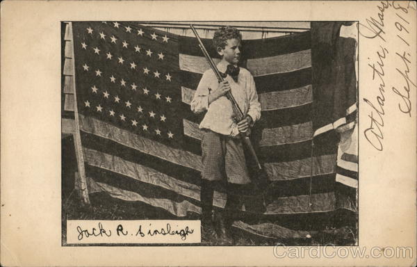 Boy in Front of Flag with Rifle Patriotic