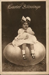 Easter Blessings - Child Holding White Bunny Sitting on an Egg