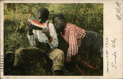 Envy - African American Boys in the grass, one eating watermelon.