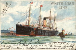 White Star Line - Cymric at Boston with two tug boats.
